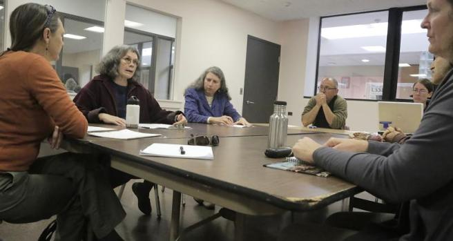 Lynne Pledger, second from left, speaks to fellow members of the Valley Zero Waste group, from left, Sue Morrello, Patrice Pare, David Starr, Jessica Tanner, John Root, and Suzanne Cordes, during its first meeting last month at the Bangs Community Center in Amherst.